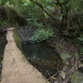 Trail and diversion canal system en route to Lulumahu Falls.- Lulumahu Falls Hike