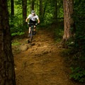 A biker heading down an early section of the Brissy Ridge Trail.- Paris Mountain State Park