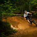 A biker banking a turn on the Brissy Ridge Trail.- Paris Mountain State Park