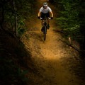 A biker heading down a series of jumps on the Brissy Ridge Trail.- Paris Mountain State Park