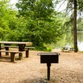 Charcoal grills and picnic tables are spread around the day-use area and are free with admission.- Paris Mountain State Park