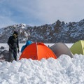 Building a snow wall to protect the tents from the wind.- Mount Whitney: Winter Mountaineers Route