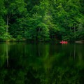 A lone kayak on Lake Placid.- Paris Mountain State Park