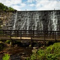 Another view of the Lake Placid Dam from below.- Paris Mountain State Park