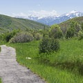 Mountains can be seen in the distance while walking along the path.- Cascade Springs