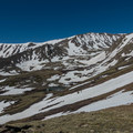A scenic drainage south of Elbert with still-frozen lakes.- Mount Elbert East Ridge Hike