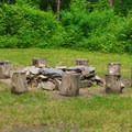 A large fire ring near a lean-to site.- Mount Ascutney State Park Campground