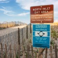 A sign at the entrance to the north inlet beach dune crossing.- Delaware Seashore State Park