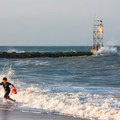A child plays in the surf at the south inlet beach.- Delaware Seashore State Park