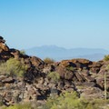 The view across the valley to Four Peaks in the Superstition Mountains.- Fat Man's Pass via National Trail