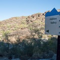 When you reach this sign, turn right to find Fat Man's Pass.- Fat Man's Pass via National Trail