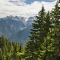 First view of the surrounding peaks along the Thornton Lakes Trail.- North Cascades National Park