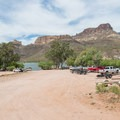 The parking area for the day use boat ramp.- Apache Lake Campground + Marina