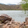Boulders make up part of the shoreline of Apache Lake, making it perfect for sitting and sunning.- Upper Burnt Corral Recreation Site
