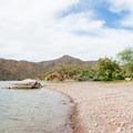 The quiet shoreline of Apache Lake.- Upper Burnt Corral Recreation Site