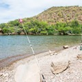Fishing in the cove.- Burnt Corral Campground