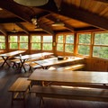 There are several tables in the main lodge.- Lonesome Lake AMC Hut