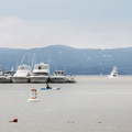 Boaters linking up on the water.- Croton Point Beach