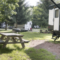 Picnic tables throughout the RV section.- Croton Point Campground
