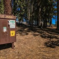 A prominent sign in the center of the campground alerts hikers to recent bear and weather activity.- Little Jimmy Campground