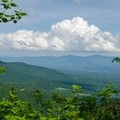 A view east toward the town and ski area of Stowe, Vermont.- Mount Mansfield via Hell Brook + Long Trails
