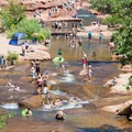 Slide Rock swimming hole on a busy weekend in June.- Slide Rock Swimming Hole