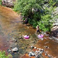 Family fun on the water.- Slide Rock Swimming Hole