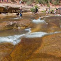 There are lots of little tiers that are good for sliding and lounging in the water.- Slide Rock Swimming Hole