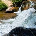 Small waterfall on Oak Creek.- Slide Rock Swimming Hole