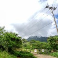 Parking is located at the end of the single-lane road before the fence.- Mount Ka'ala