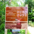 The pet beach access point and rules regarding pet use.- Red Trail