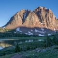Red Castle Peak dominates the backdrop of Lower Red Castle Lake.- Red Castle Lakes + Wilson Peak