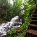 A hiker looks out over Onondaga Falls.- Ricketts Glen State Park