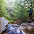 A hiker looking out over Onondaga Falls.- Ricketts Glen State Park