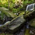 Massive boulders help guide the B. Reynolds Falls downstream.- Ricketts Glen State Park