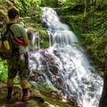 A hiker looks out over Ganoga Falls.- Ricketts Glen State Park