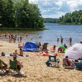Families relax on the sandy banks of Lake Jean.- Ricketts Glen State Park