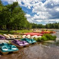 Various boats, including kayaks, canoes, and paddleboats are available to rent.- Ricketts Glen State Park