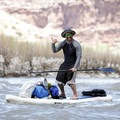 Stand-up paddling through a Class I rapid.- Colorado River: Ruby Horsethief Canyon