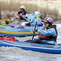 Rafting and kayaking through a Class I rapid.- Colorado River: Ruby Horsethief Canyon
