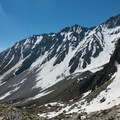 Looking back at the snowy ridgelines under the col.- Tour Du Mont Blanc: Stages 7 + 8
