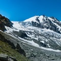 Wide view of the glacier and valley below.- Tour Du Mont Blanc: Stages 7 + 8
