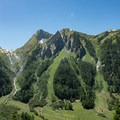 Wider angle of the grassy slopes across the valley.- Tour Du Mont Blanc: Stages 7 + 8