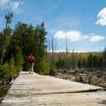 The hike begins by crossing a boardwalk.- Mount Pisgah via South Trail