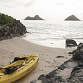 Launching a kayak from the beachless access point southeast of the main stretch.- Lanikai Beach
