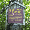 A sign signals the 3,500-foot elevation mark.- Balsam Lake Fire Tower