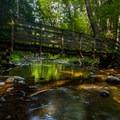 A footbridge to Van Campens Falls.- Van Campens Glen Hike