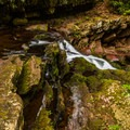 A small waterfall along the trail.- Van Campens Glen Hike