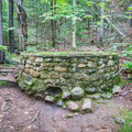 Remains of the old springhouse along the Starr King Trail.- Mount Starr King + Mount Waumbek
