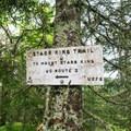 A summit sign on Mount Waumbek.- Mount Starr King + Mount Waumbek